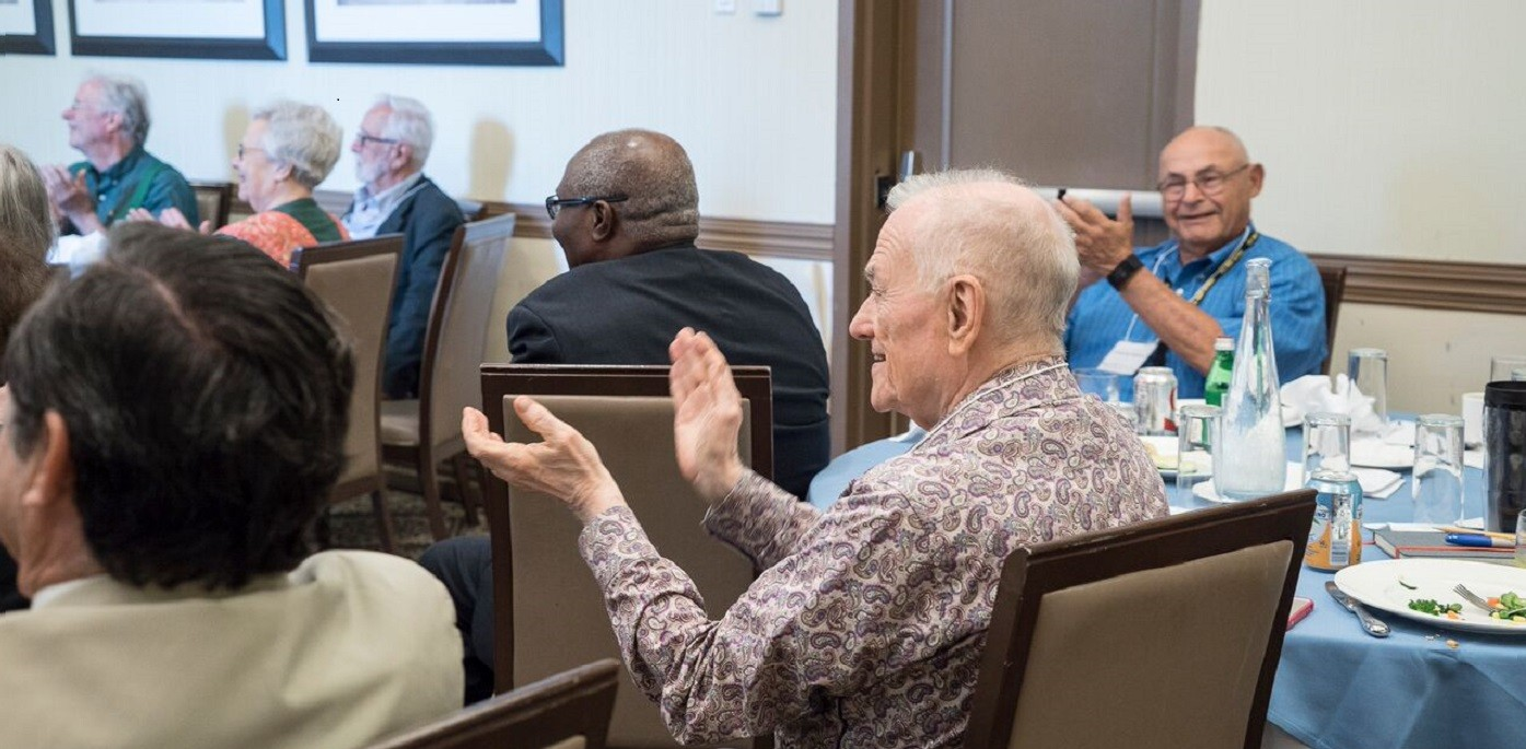 EPIC members applauding a presentation